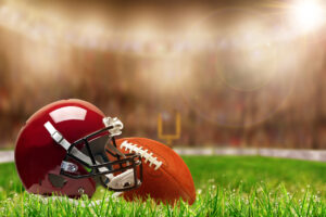 CFL Helmet and ball on grass